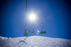 Ski lift with sun Royalty Free Stock Image