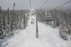 Ski lift to top of mountain Stock Photography