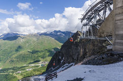 The ski lift to the top of the mountain at an altitude of 2400 meters in the Alps Stock Photos