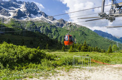 The ski lift to the top of the mountain at an altitude of 2400 meters in the Alps Stock Photo