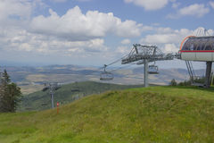 Ski lift on on the top of mountain Royalty Free Stock Photos