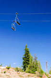 Ski Lift and Trees. Ski lift with a deep blue sky passing over green pine trees in the summer on Mount Hood Stock Photography