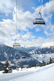 Ski lift in winter mountain. Empty ski lift in beautiful winter snowy mountain landscape (resort in Alps Stock Images
