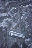Ski lift in winter scene. Close up of single ski lift with snowy forest background, Mount Rose ski resort, Reno, Nevada, U.S.A stock photos