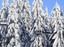Ski lift in   a winter sunny day   Czech Republic. Royalty Free Stock Photos