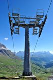 Ski lifts. In the rocky mountains of the Dolomites royalty free stock photos