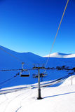 Ski lifts. Riding the lift under great winter sunlight Stock Photos