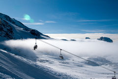 Ski lifts above the clouds Royalty Free Stock Photography