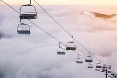 Ski lifts above the clouds Royalty Free Stock Images