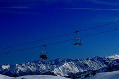 Ski lifts in alps mountains Stock Photos