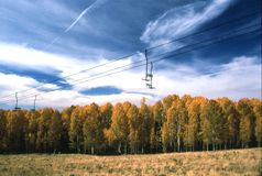 Ski Lifts in Autumn. Ski lifts at Arizona Snow Bowl during an aspen fall color display Royalty Free Stock Photography