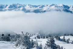 Ski lifts and Clouds at Zillertal Arena ski resort Austria. Ski lifts and Clouds at Zillertal Arena ski resort in Zillertal in Tyrol. Mayrhofen in Austria in stock photography