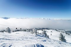 Ski lifts and Clouds Zillertal Arena ski resort Austria. Ski lifts and Clouds in Zillertal Arena ski resort in Zillertal of Tyrol. Mayrhofen in Austria in winter stock images