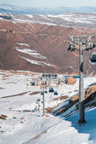The ski lifts durings bright winter day Royalty Free Stock Photos