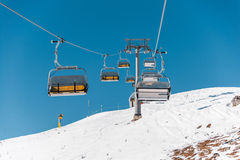 The ski lifts durings bright winter day Royalty Free Stock Image