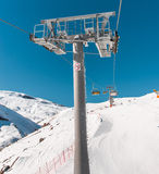 Ski lifts durings bright winter day Royalty Free Stock Photos
