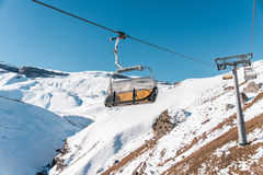 Ski lifts durings bright winter day Royalty Free Stock Image