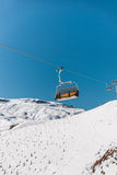 Ski lifts durings bright winter day Royalty Free Stock Images
