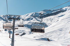 Ski lifts durings bright winter day Stock Photos
