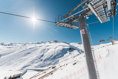 Ski lifts durings bright winter day Stock Photo
