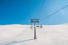 Ski lifts durings bright winter day Royalty Free Stock Photo