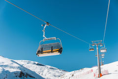 Ski lifts durings bright winter day Royalty Free Stock Photography