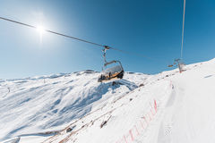 The ski lifts durings bright winter day Stock Photography