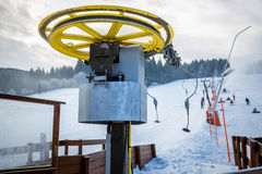 Ski lifts mechanism on foot of high mountain at Alps Royalty Free Stock Photography