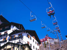 Ski lifts moving up and down Royalty Free Stock Photos