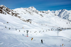 Ski lifts, skiers and snowboarders in Solden, Austria Royalty Free Stock Image