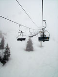 Ski lifts on snowy mountain Stock Images