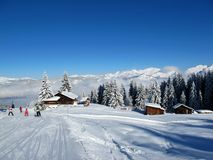 Ski Lodge in French Alps. Skiers near log lodge in French Alps royalty free stock image