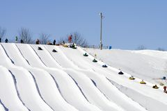 Ski Lodge Snow Tubers Stock Photos