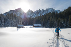 Ski mountaineer reaches alpine hut. Royalty Free Stock Photography
