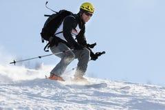 Ski mountaineer rides skiing on mountain on background of blue sky Royalty Free Stock Photo