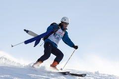 Ski mountaineer rides skiing on mountain on background of sky Stock Photo