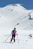 Ski mountaineering Championship: girl ski mountaineer rides skiing from volcano Royalty Free Stock Images
