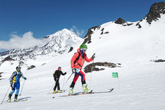 Ski mountaineering Championships: group ski mountaineer climb on skis on background volcano Stock Images