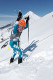 Ski mountaineering Championships: ski mountaineer climb to mountain with skis strapped to backpack Royalty Free Stock Image