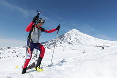 Ski mountaineering Championships: ski mountaineer climb to mountain with skis strapped to backpack Royalty Free Stock Photo