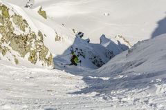 Ski mountaineering during the descent couloir. Stock Photo