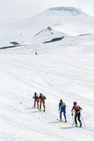 Ski mountaineering: group ski mountaineer rise to volcano on skis Stock Photos