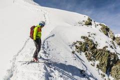 Ski mountaineering prepares to exit. Royalty Free Stock Images