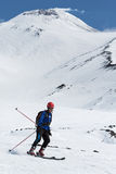 Ski mountaineering: ski mountaineer rides skiing from volcano Stock Photos
