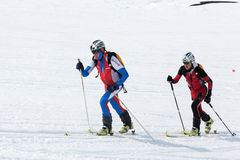 Ski mountaineering: two ski mountaineer rise to mountain on skis Royalty Free Stock Photography