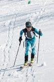 Ski mountaineering, Vertical race: ski mountaineer climb on skis on mountain. MOUNTAIN MOROZNAYA, ELIZOVO, KAMCHATKA, RUSSIA - APRIL 25, 2014: Vertical race. Ski Royalty Free Stock Photo