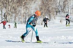 Ski mountaineering, Vertical race: ski mountaineer climb on skis on mountain. MOUNTAIN MOROZNAYA, ELIZOVO, KAMCHATKA, RUSSIA - APRIL 25, 2014: Vertical race. Ski Stock Image