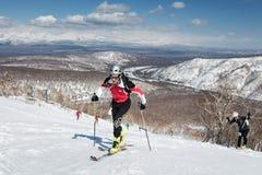 Ski mountaineering, Vertical race: ski mountaineer climb on skis on mountain. MOUNTAIN MOROZNAYA, ELIZOVO, KAMCHATKA, RUSSIA - APRIL 25, 2014: Vertical race. Ski Royalty Free Stock Photos