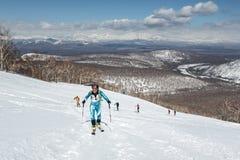 Ski mountaineering, Vertical race: ski mountaineer climb on skis on mountain Stock Photo