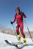 Ski mountaineering, Vertical race: ski mountaineer climb on skis on mountain. MOUNTAIN MOROZNAYA, ELIZOVO, KAMCHATKA, RUSSIA - APRIL 25, 2014: Vertical race. Ski Royalty Free Stock Photography